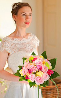 This romantic look will create a big impact as you walk down the aisle. Bouquet of David Austin Roses in shades of pink with hints of yellow and green