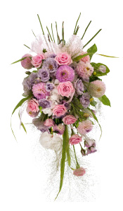Pew end of pink dahlias, white hydrangeas, Panicum fountain grass, pink Heaven roses, salal mixed foliage and lilac spray roses, Flower Design Studios