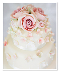 Impeccable sugar flowers on top of a Liggy's Cake Company creation