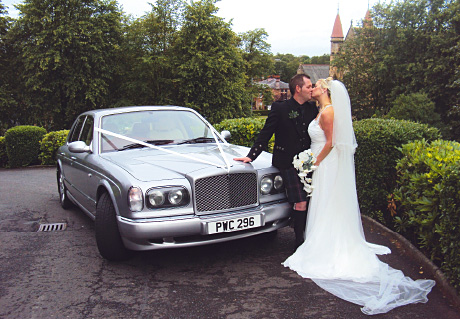 : a sleek and luxurious car from West of Scotland Chauffeur Drive (westofscotlandchauffeurdrive.co.uk) is a great choice for stylish, modern couples