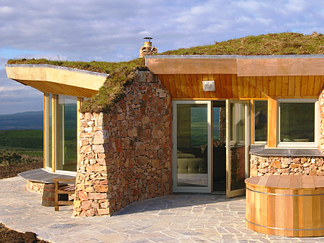 With unspoilt views of the stunning surrounding landscape, the turfed-roof cottage of Coillabus on Islay is set in a secluded spot that makes it an ideal honeymoon escape