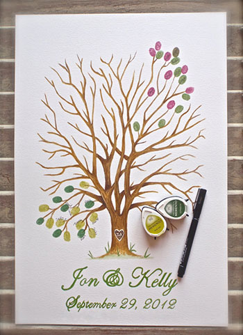 2. Fingerpaint guest book tree with two ink pads and pen, £54.43, The Inky Bean at etsy.com