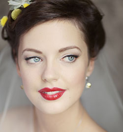 A vintage-inspired look by Karen Bowen, with eye-catching red lips, glam black eyeliner and perfect brows.