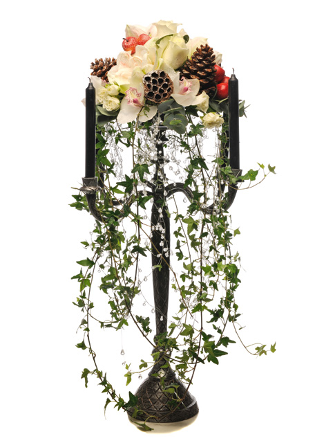Candelabra with amaryllis, roses and orchids, mixed with  apples, acorns and trailing ivy, Ann Baff Flowers