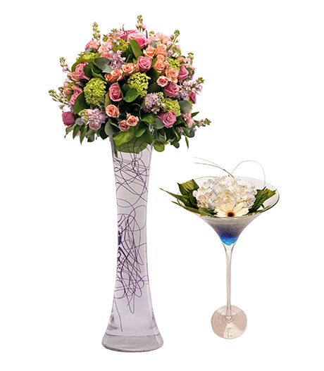 Domed hourglass arrangement of Heaven roses, spray roses, Guelder roses, stocks and foliage by Mood Flowers and Martini glass arrangement with hydrangeas and gerberaas,  Flowers in Thyme