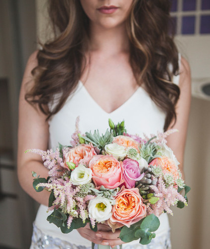A picture-perfect pastel-hued  hand-tied bouquet by Narcissus  Wedding Flowers by Susan,  www.weddingflowersbysusan.co.uk  Photo: Tandem Photo,  www.tandemphoto.co.uk