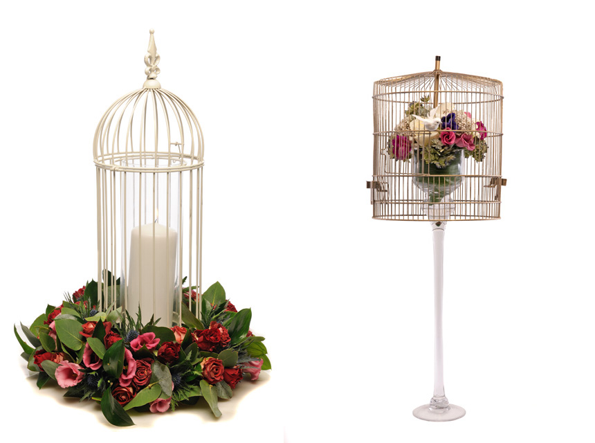 Birdcage candle table decoration with roses and thistles,  Nikki's Fleurs and Birdcage display of pink lisianthus, dried rice  flowers, dried hydrangeas,  Avalanche roses, calla lilies, anemones and pearl detailing, The Black Orchid