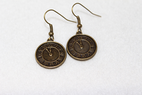 These quirky pieces won't turn into pumpkins when the clock chimes midnight! Clock earrings in antique bronze, £3.99, RogueJewels at Etsy.com