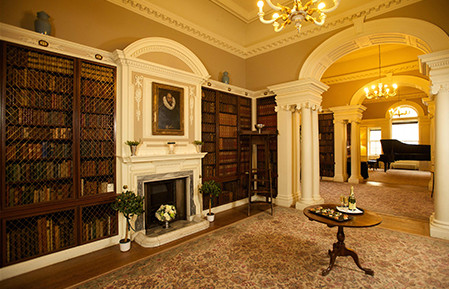 The elegant Pollok House library, complete with original artwork, columns and fireplace, is a great place for canapés and conversation;