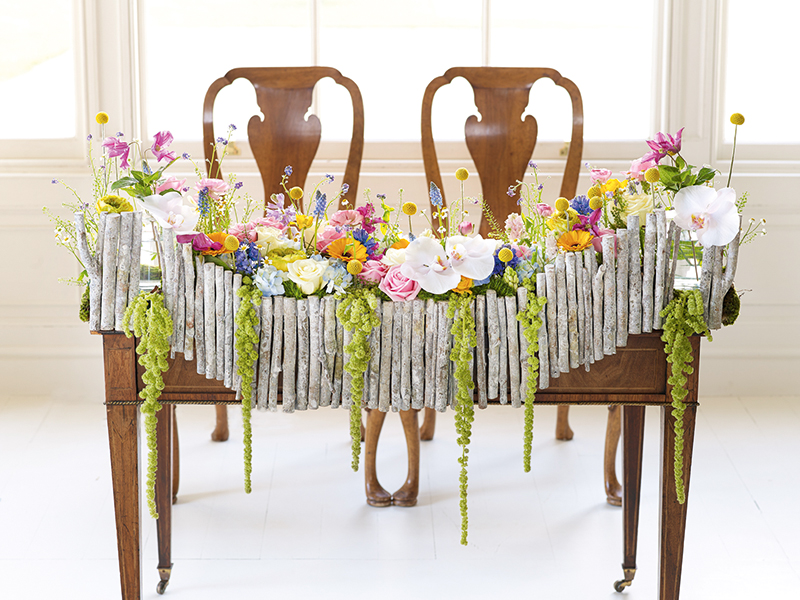 Don't feel you have to stick to the rules. A top table for two carpeted in flowers? Yes please!
