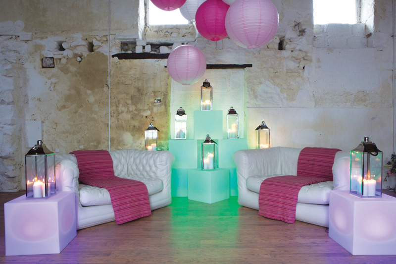 Get Knotted's LED Light Cube seats (£20 to hire) also work as tables – here the contemporary glow is topped with lanterns