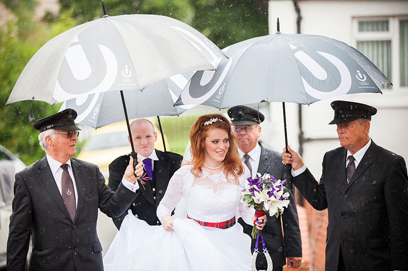 24. white tree photography bride under umbrellas