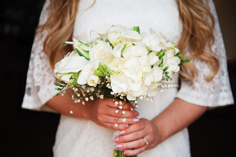 An all-white bouquet of hydrangea, freesia, crystal blush calla, baby's breath and parrot tulips by Lorraine Wood Flowers