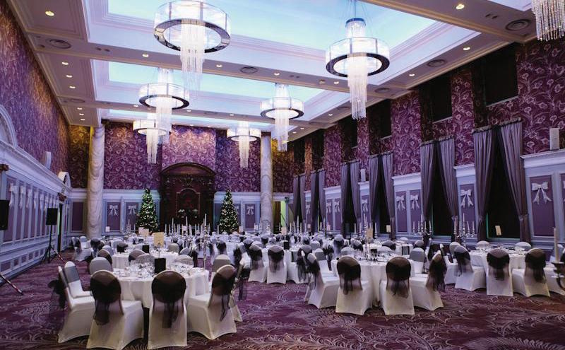 Deep plum tones and prickly leaved carpeting recall Scotland's national flower in the Grand Central Hotel's ballroom