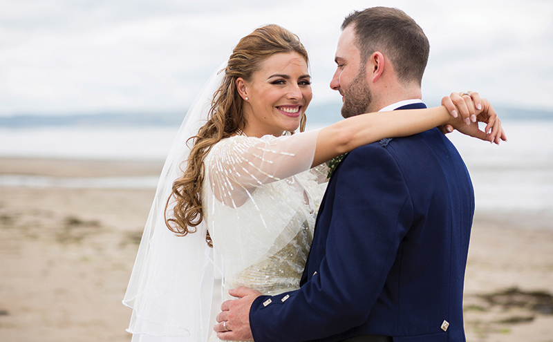 Allow your happiness to shine through: we can't stop grinning right back at this bride