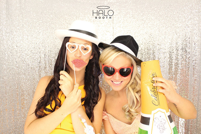 It's props o'clock thanks to the team at Halo Booth. Hats, lips, glasses and champagne: a snap made in heaven