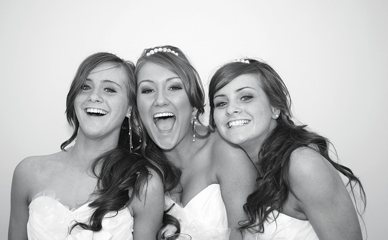 Three bridesmaids strike a pose in The Photocube