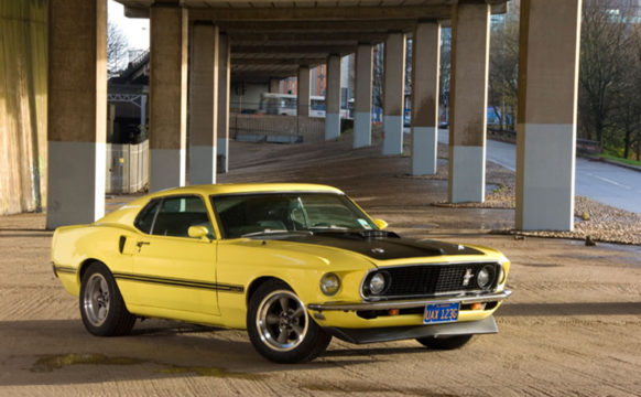 10_47-Star-Car-HireYellow-Ford-Mustang-sunshine-angle-shot.jpg
