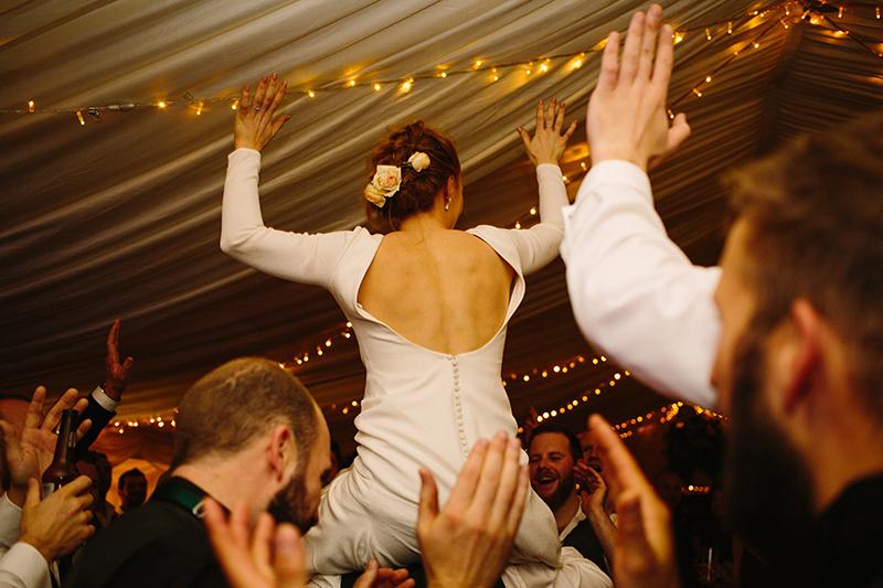 bride on shoulders