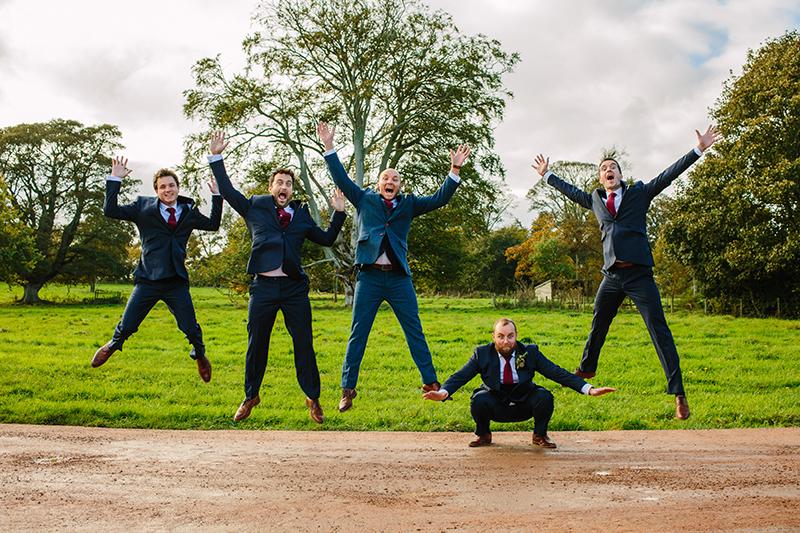 grooms and groomsmen jumping