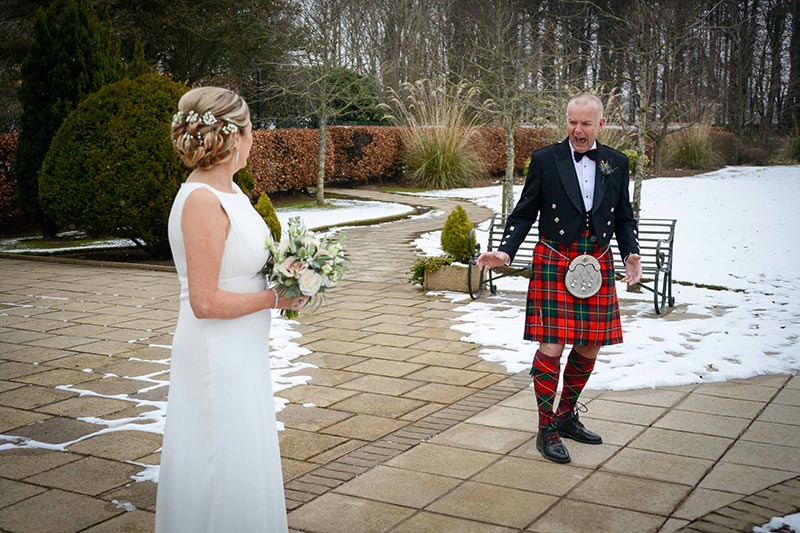 Groom seeing bride in garden