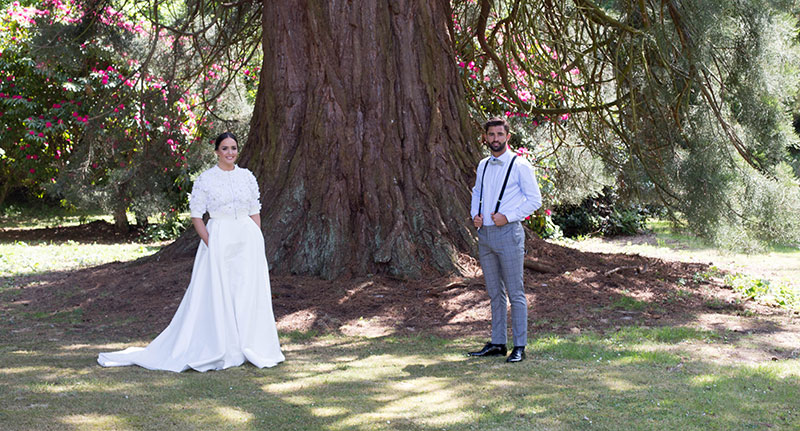 Couple standing in front of tree