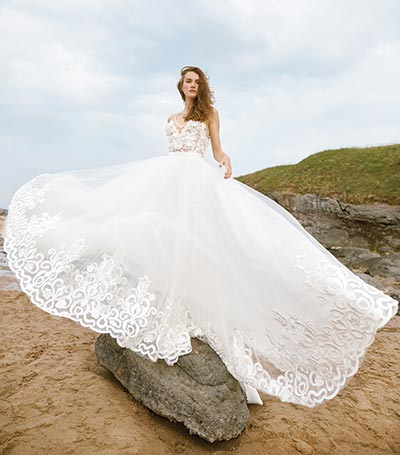 Positano gown with intricate floral appliquéd bodice by Eleganza Iconica, from £3,000, Eleganza Sposa