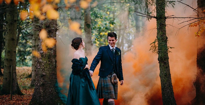 couple walking through woods