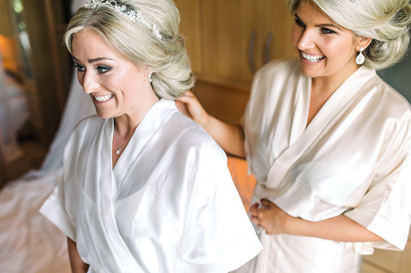 bridesmaid helping bride