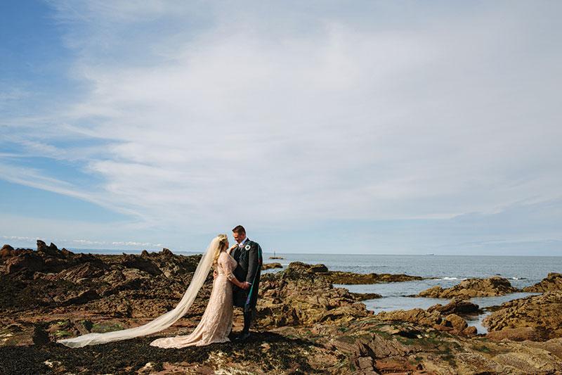 couple posing on shore