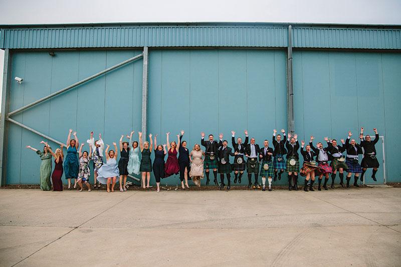 wedding guests jumping