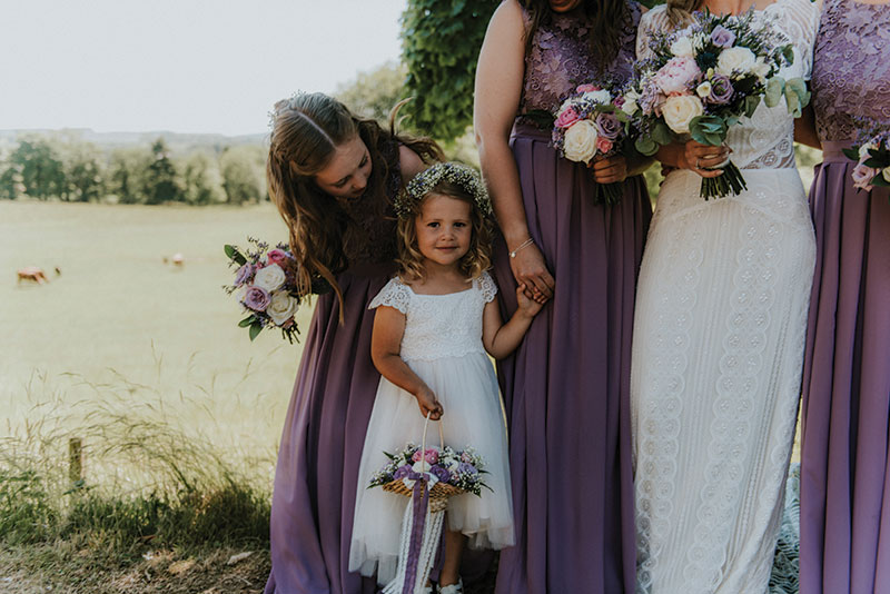 flowergirl with bridesmaids