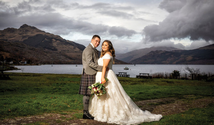Couple in front of loch