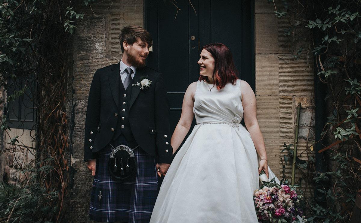 couple posing in doorway