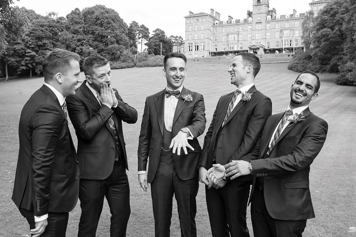 groom-joking-around-with-groomsmen