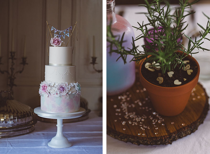 wedding cake with pastel flowers and plant in pot for centrepiece