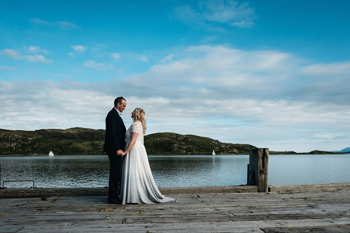 bride and groom at tighnabruaich pier