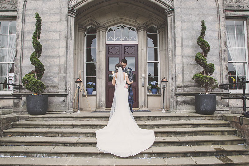 bride and groom posing in grounds of airth castle