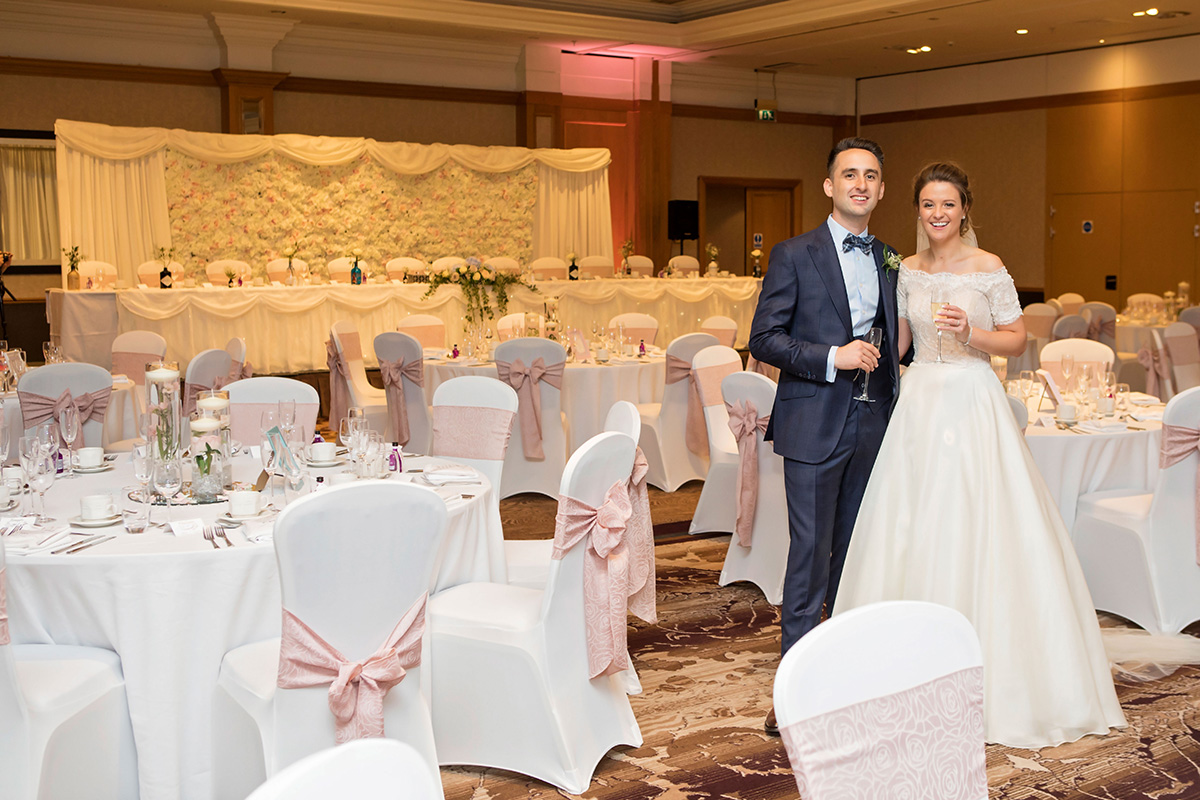 bride-and-groom-in-ballroom-at-dunblane-hydro-with-pastel-colour-scheme