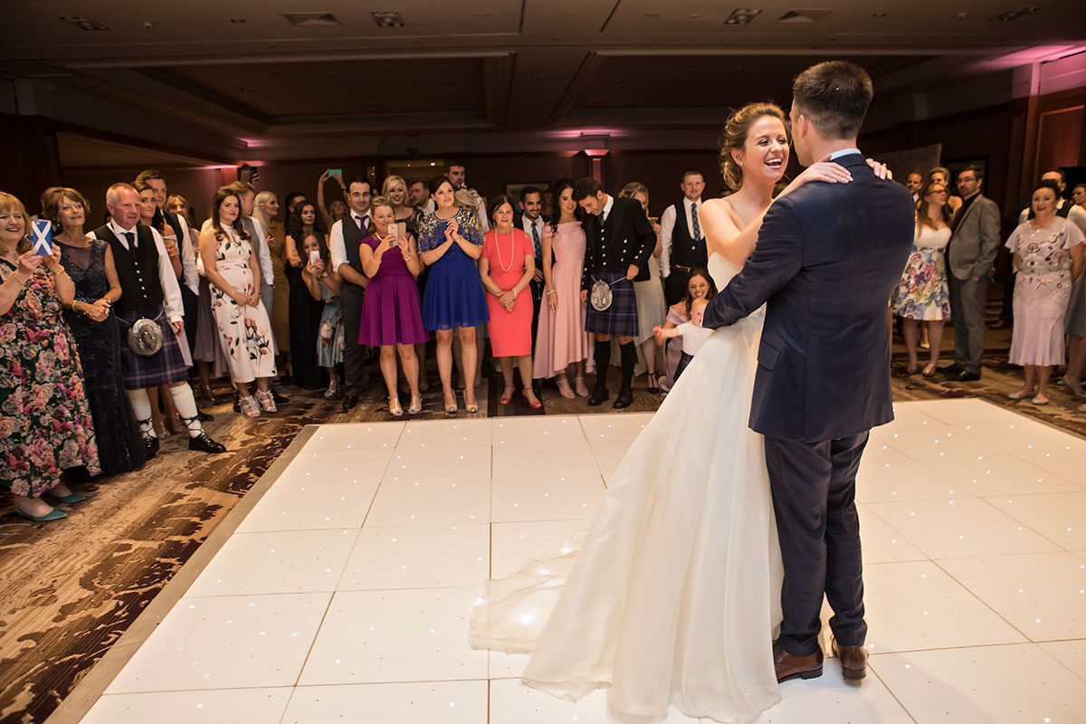 bride-and-groom-having-first-dance-on-light-up-dancefloor