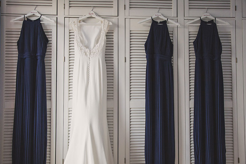 bride and bridesmaid dresses on shutters