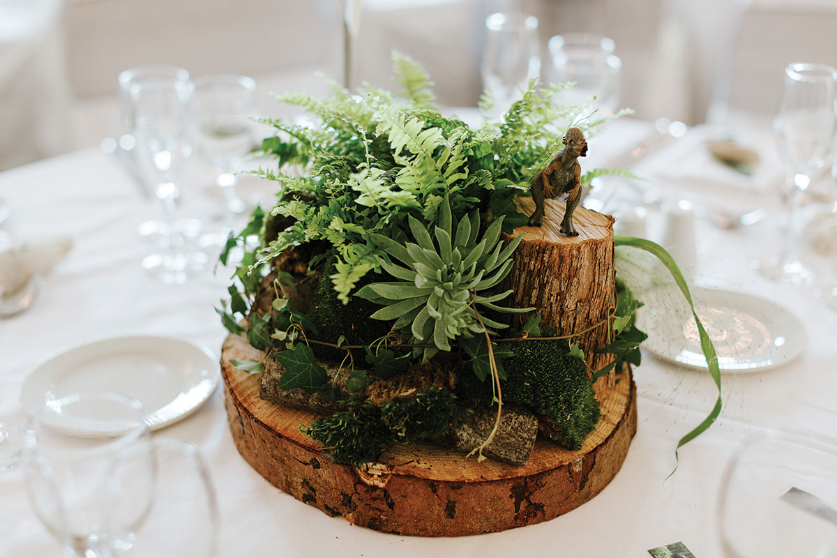 rustic centrepiece with logs, succulents and moss
