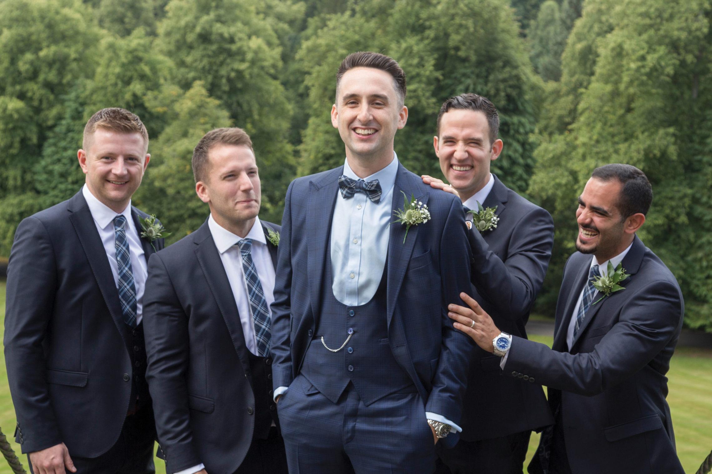 groom-and-groomsmen-in-navy-kilts