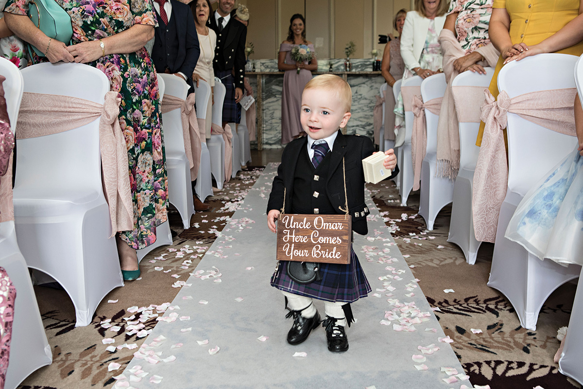 toddler-wearing-kilt-and-personalised-wedding-sign