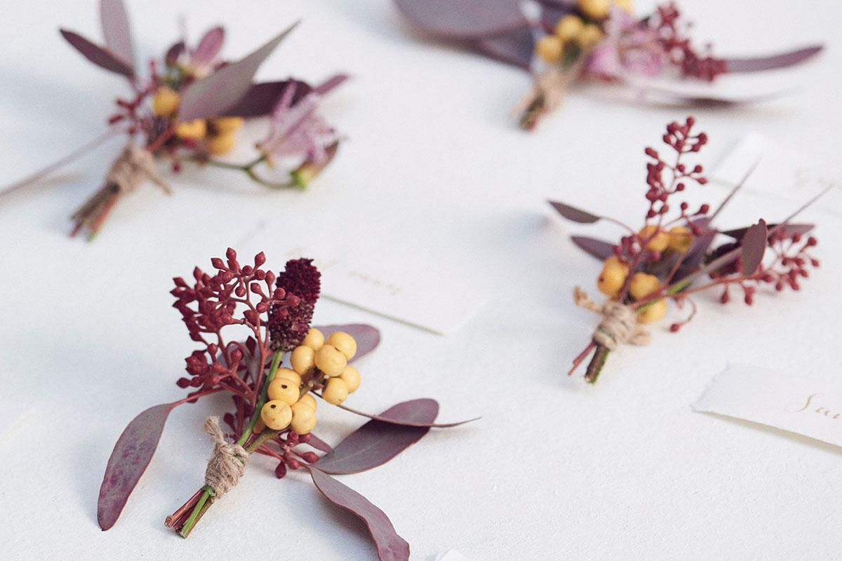 vibrant berry buttonholes