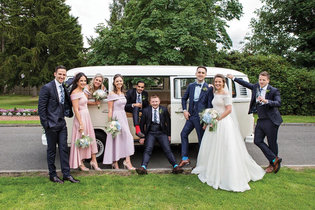 bridal-party-posing-in-VW-camper