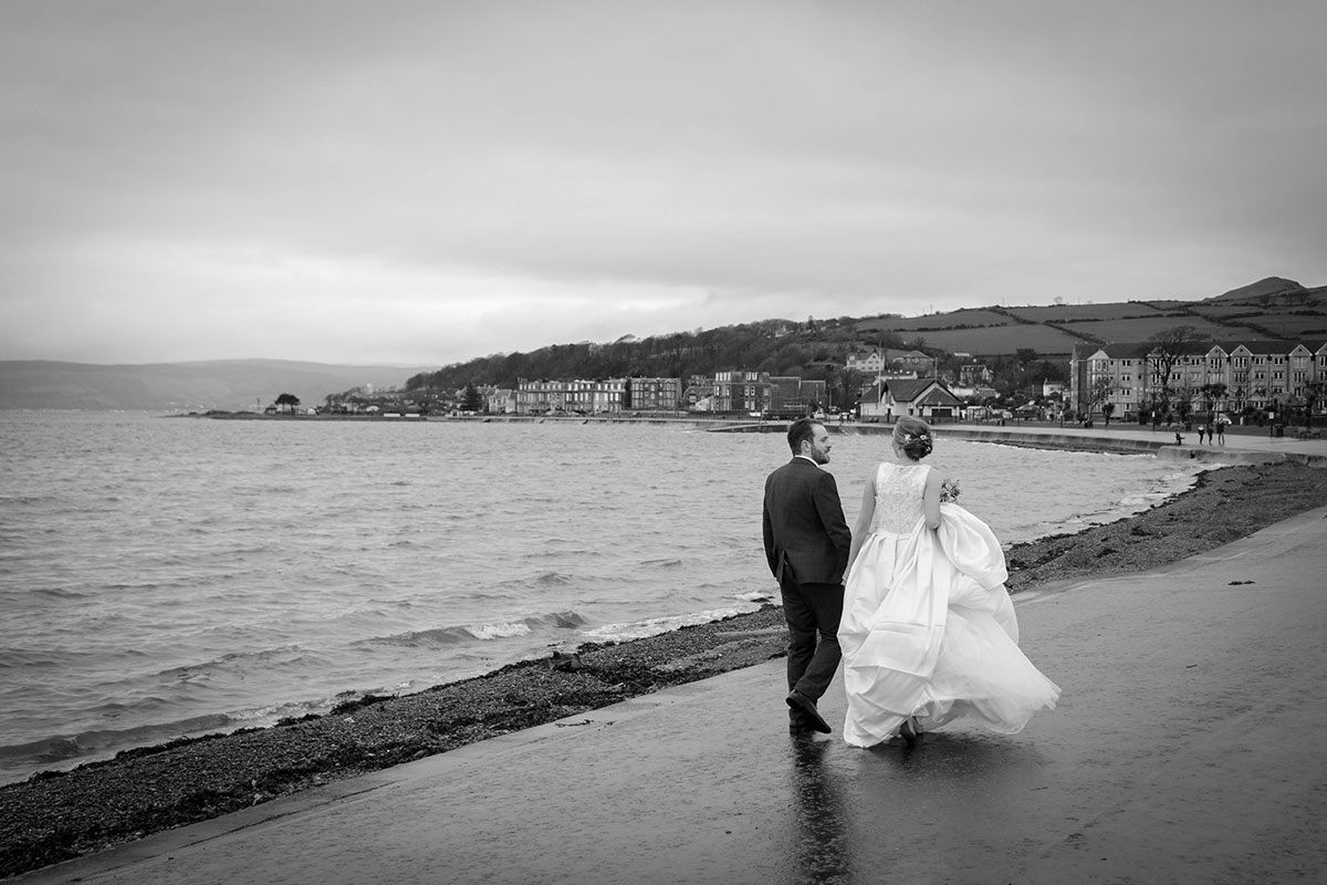 bride-and-groom-walking-by-the-shore