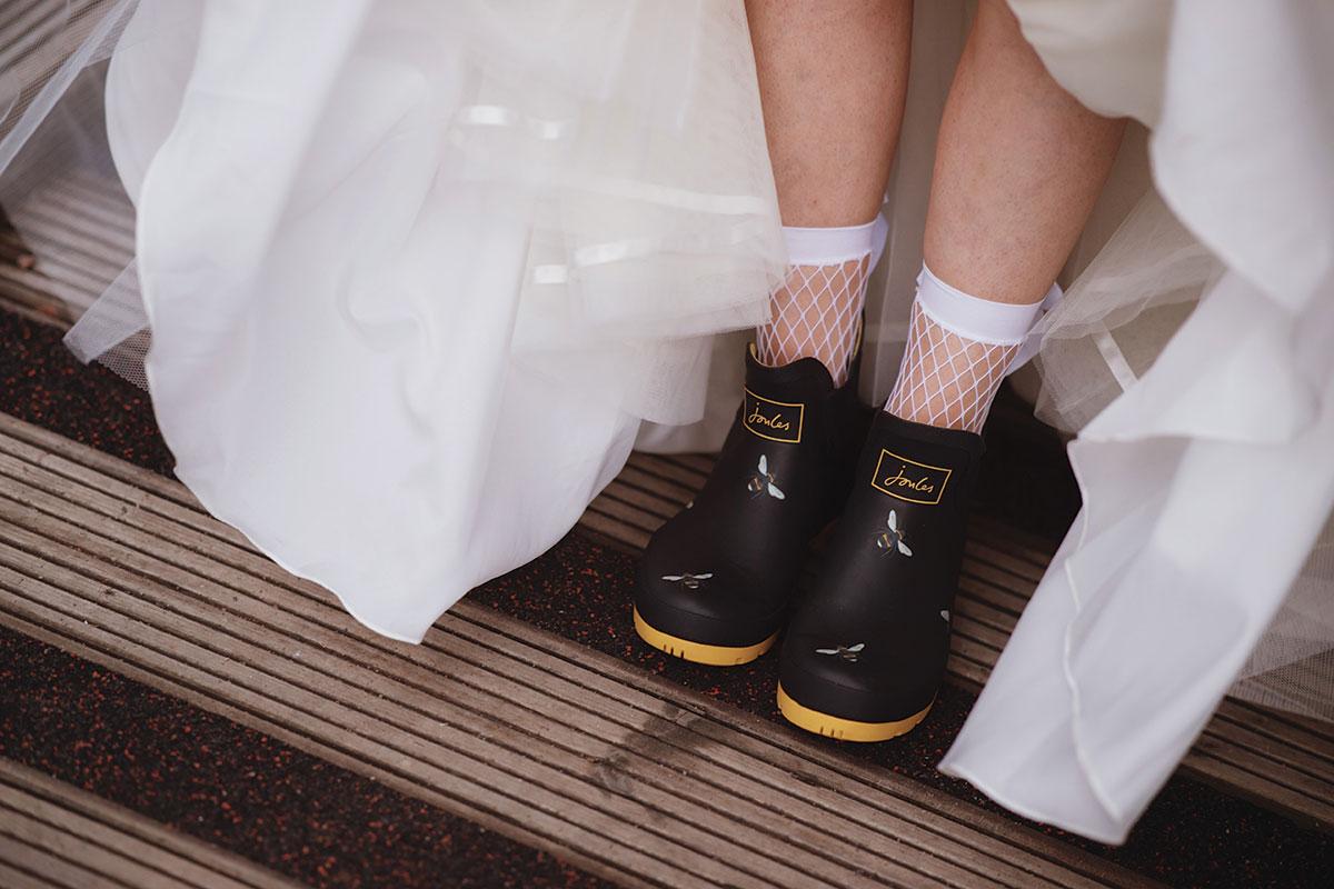 bride-wearing-fishnet-socks-and-joules-wellies