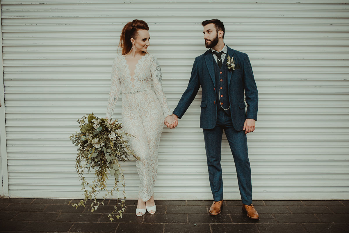 bride-and-groom-against-white-grill