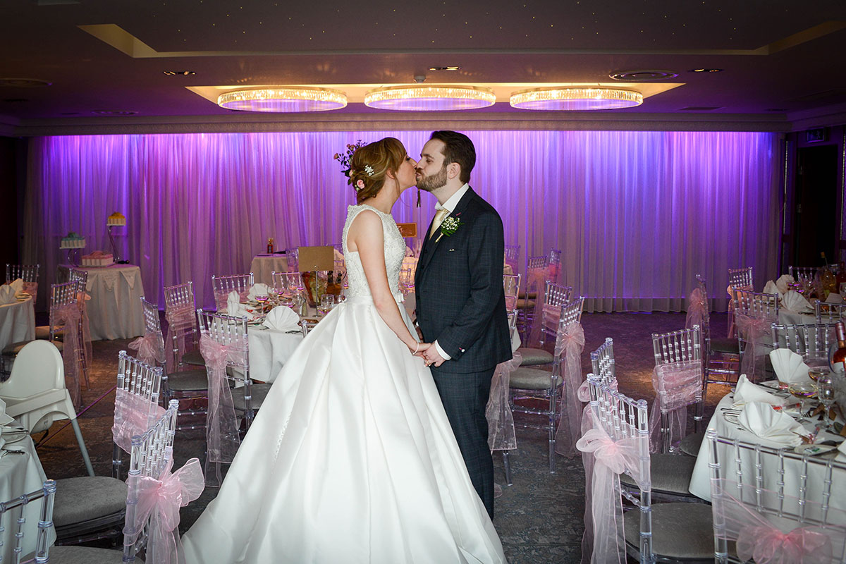 bride-and-groom-kissing-in-reception-room-at-brisbane-house